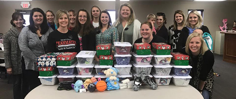 The Wayne MOPS (Mothers of Preschoolers) do a variety of local service projects. Recently, they helped fill shoeboxes for the Shoebox Mission project that sent more than 600 shoeboxes full of items to children in other countries. (From Wayne MOPS Facebook page)