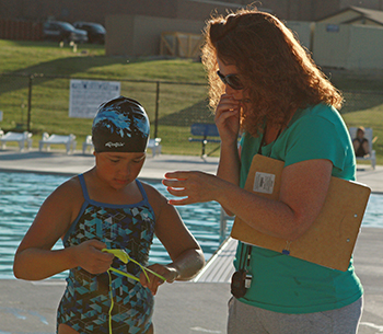 Andrea Cooper Helps Olivia Scardino Fix Her Eye Goggles During A Recent Practice At The Wayne Community Activity Center Dolphins Swimmers Will